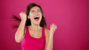 stock-footage-excited-winner-woman-celebrating-winning-something-very-happy-ecstatic-woman-jumping-and-screaming